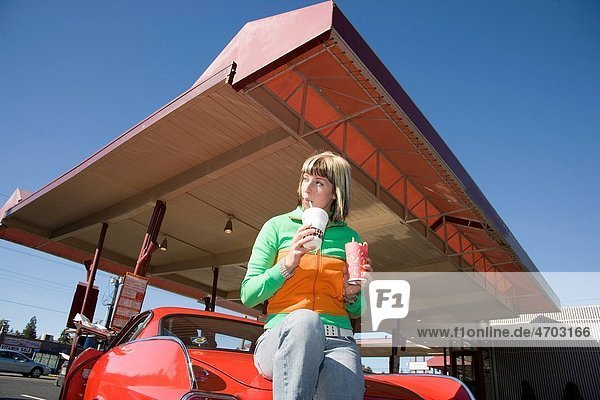 Woman eating at drive_in restaurant