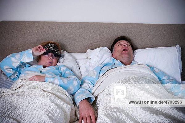Woman awakened by snoring husband