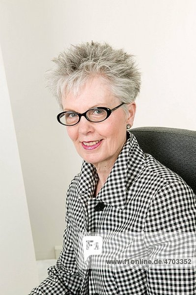Portrait of middle aged woman with glasses