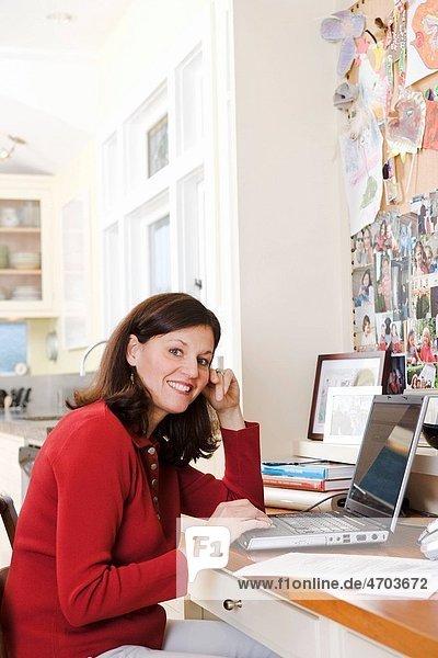 Portrait of woman using laptop computer