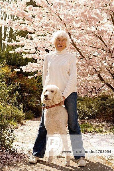 Portrait of senior woman with dog