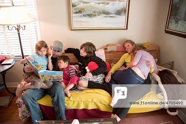 Family reading on sofa