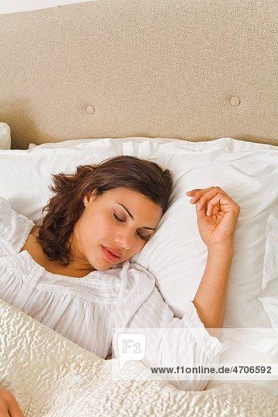 Woman sleeping in comfortable bed