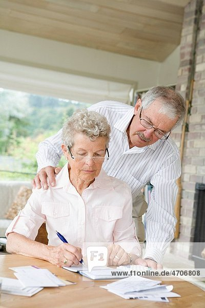 Couple preparing home finance budget