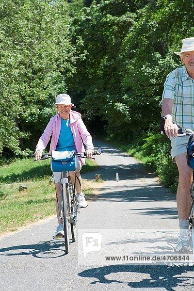 Couple riding their bicycles  Washington State  USA