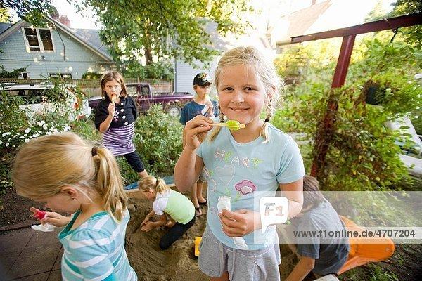 Children eating popsicles