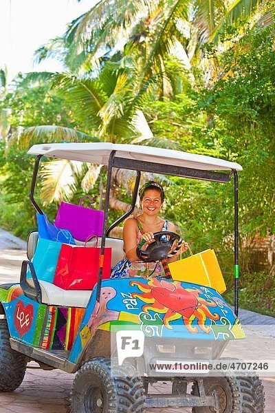 Woman shopping with golf cart in mexico
