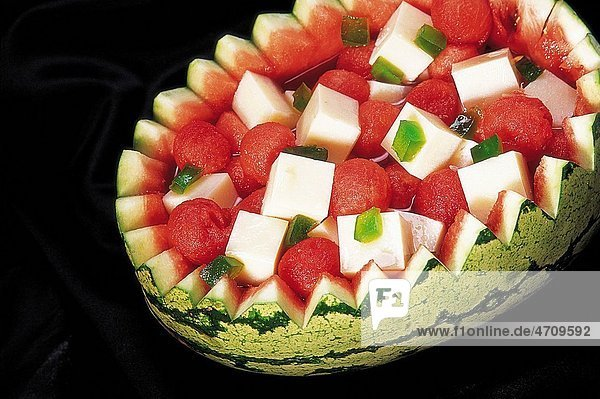 Sweet dish   Chinese cuisine   Almond Bean Curd and watermelon pieces on black background