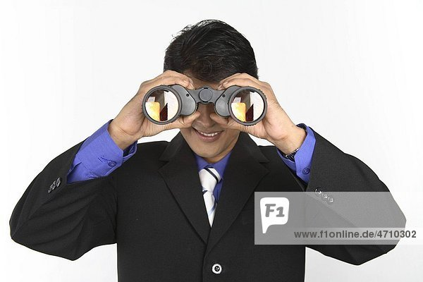 Executive holding binocular and looking through it MR687M