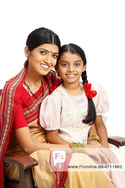 Indian farmer daughter sitting on mother lap MR743B 743C