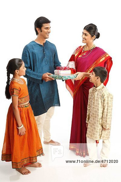 Rich rural farmer giving gift boxes to wife children standing with them MR743A 743B 743C 743D