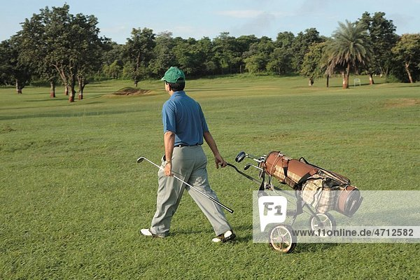 Golf player on move at golf course MR 372