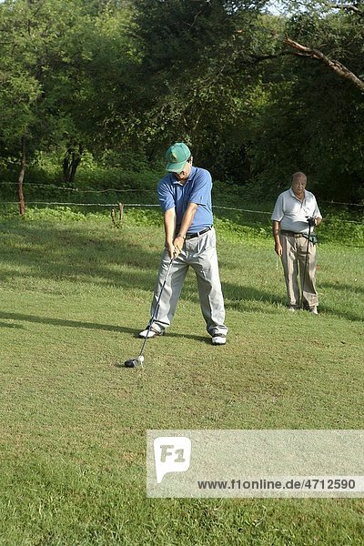 Golf player concentrated on ball MR 372