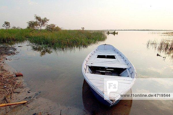 Empty Boat in Lake at sunset   Nalsarovar bird sanctuary   Gujarat   India