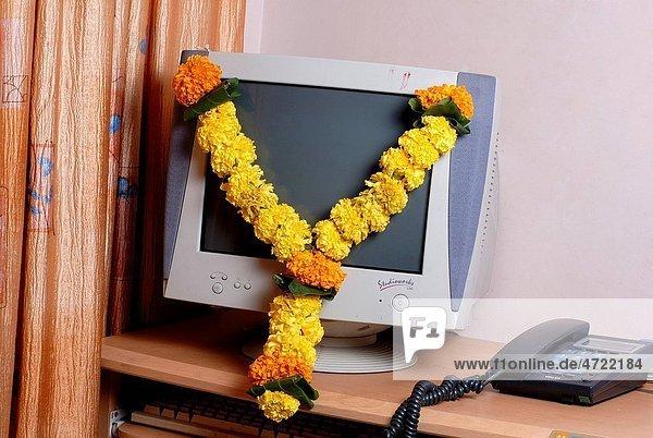 Marigold garland on Computer for prayer on Indian Dussera dusera Festival