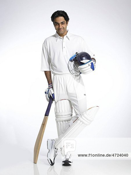 Indian batsman holding helmet and bat ready for cricket match MR702A