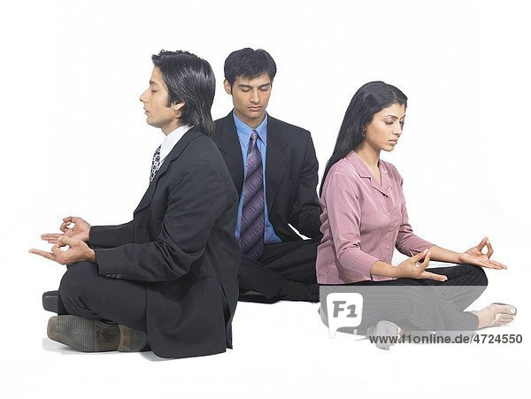 South Asian Indian executive men and woman doing yoga MR