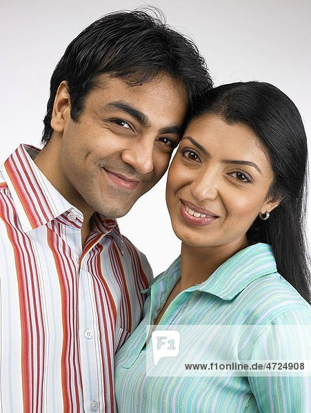 Indian man and woman close to each other MR702A 702L