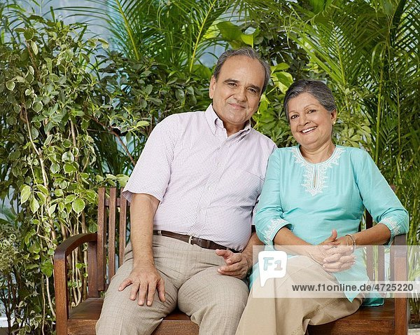 Old couple sitting on wooden bench MR702T 702S