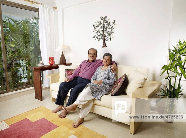 Old couple embracing sitting on sofa MR702T 702S