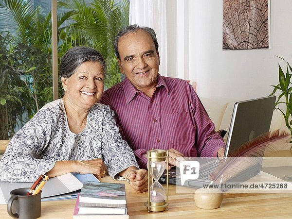 Old couple operating laptop MR702T 702S