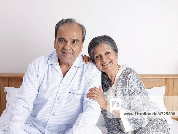 Old couple sitting close to each other on bed MR702T 702S