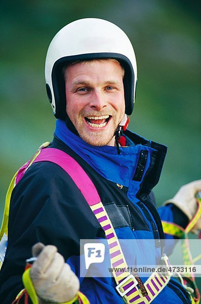 Portrait of paraglider laughing