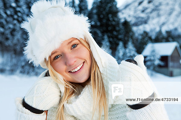 Portrait of girl wearing winter clothes  outdoors