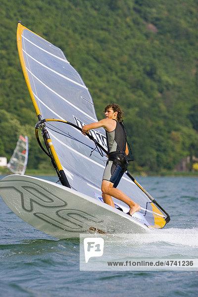Wind surfer surfing on Lake Kaltern  Province of Bolzano-Bozen  Italy  Europe