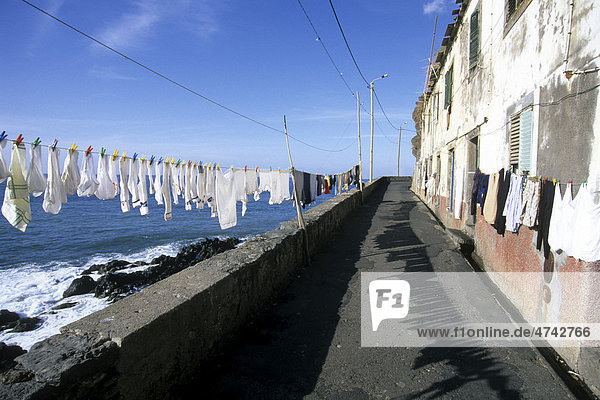 Street with laundry on the clothesline in the fishing village of Camara de Lobos  Madeira Island  Portugal  Europe  Atlantic Ocean