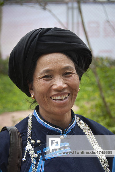 Portrait  woman of the Yi or Hani ethnic minority wearing a dark traditional dress with a turban  Jiangcheng  Pu'er City  Yunnan Province  People's Republic of China  Southeast Asia  Asia