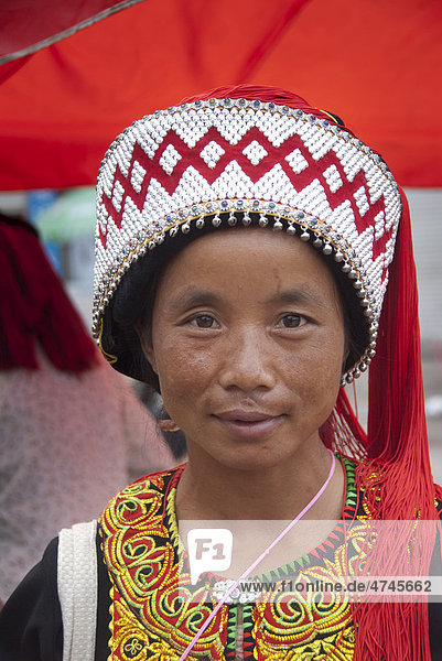 Woman of the Yi or Hani ethnic minority wearing colourful headware at a festival  portrait  Jiangcheng  Pu'er City  Yunnan Province  People's Republic of China  Southeast Asia  Asia
