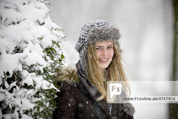 A portrait of a young woman outdoors in the snow
