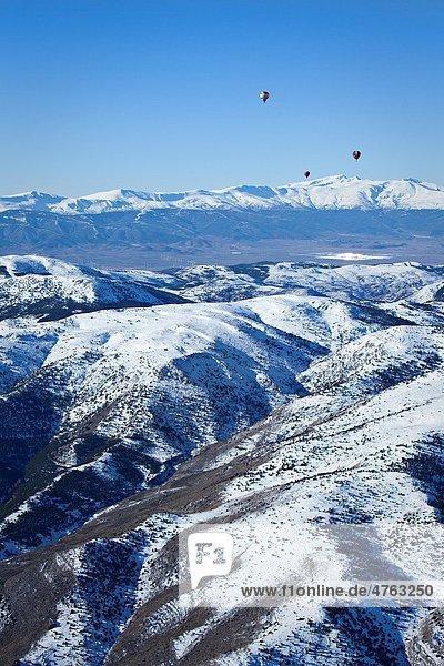 Balloons flying over the Sierra de Baza and toward Sierra Nevada