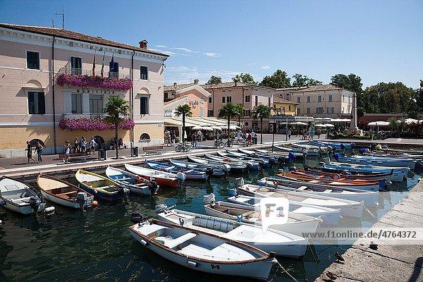 Small boats used by local fishermen tied up in the marina at Bardolino  Lake Garda  Italy