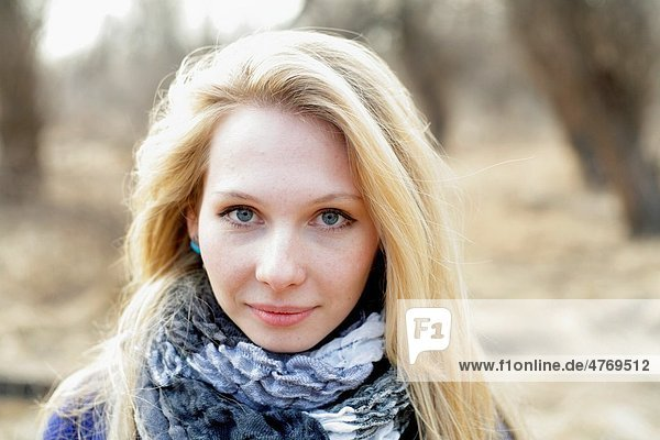 Portrait of beautiful woman in autumn outdoors