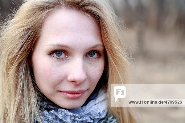 face of beautiful woman in autumn outdoors