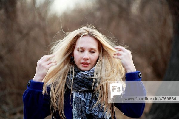 Portrait of beautiful woman in autumn outdoors in blue coat