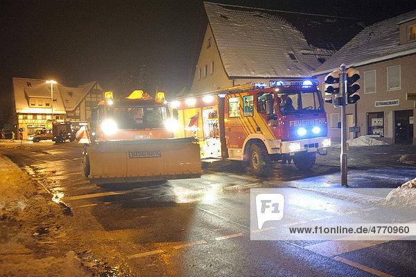 Winter services scattering salt on the road  ice hazard through water used for for firefighting  Kirchheim unter Teck  Baden-Wuerttemberg  Germany  Europe