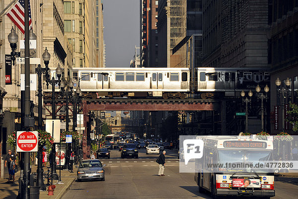 Elevated train lin in Chicago  and El  L  CTA  bus  taxi  Chicago  Illinois  United States of America  USA