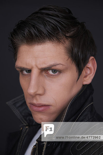 Young man wearing a leather jacket  portrait