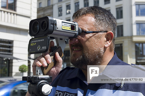 Police officer with a laser gun for speed monitoring  Berlin  Germany  Europe