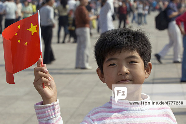 Boy waving a small national flag of the People's Republic of China  Tiananmen Square  Beijing  China  Asia