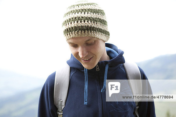 Young man with hat and backpack  Kitzbuehel Alps  Kitzbuehel  Tyrol  Austria  Europe