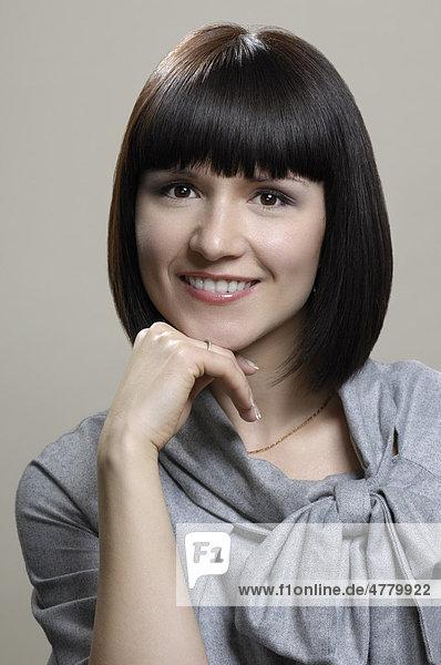 Lächelnde junge Geschäftsfrau  Porträt