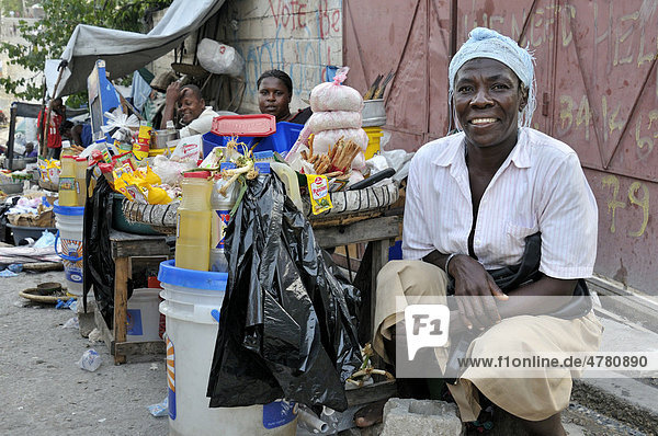 Woman selling products on the street  the slums of Fort National  the district was largely destroyed by the earthquake in January 2010  Port-au-Prince  Haiti  Caribbean  Central America