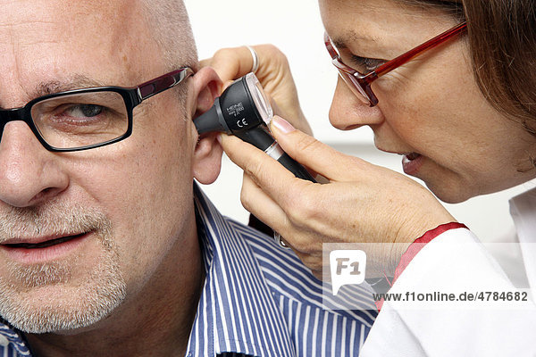 Medical practice  doctor with patient  aural examination