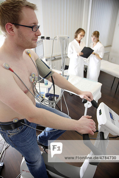 Medical practice  stress ECG  test to measure the cardiac function of a patient on a cardio machine