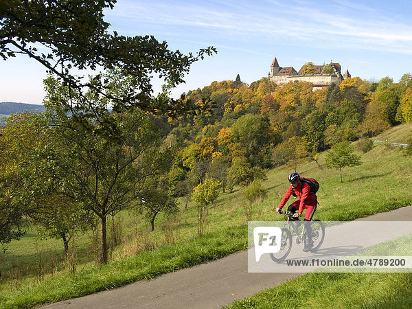 Cyclists in front of the Veste Coburg castle  Coburg  Upper Franconia  Franconia  Bavaria  Germany  Europe