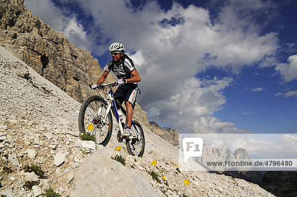 Mountain bike pro Roland Stauder in front of Mt. Paternkofel  Alta Pusteria  Dolomites  South Tyrol  Italy  Europe